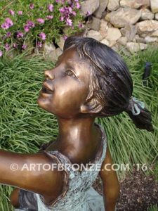 Enchanted Butterfly fantasy bronze sculpture of girl sitting on giant leaf with butterfly