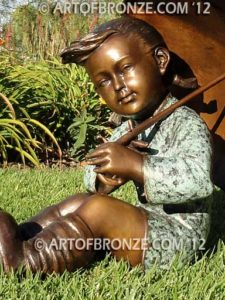 Summer Breeze bronze sculpture of cute young girl in the sun with umbrella