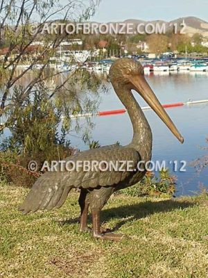Heavenly Retreat bronze statue of resting pelican standing and looking for fish