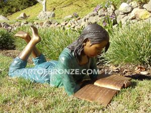 Best in Her Class bronze statue of girl lying down reading book