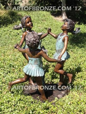 Ring Around fountain sculpture of three girls holding hands and dancing around