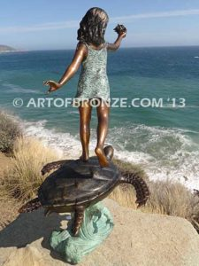 A Treasured Day Backview A Bronze Statue of Girl Holding Shell