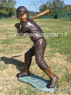Home Run bronze sculpture of boy playing baseball hitting ball