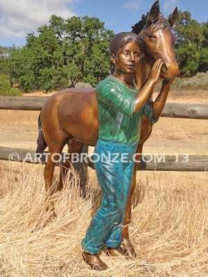 Dreams Come True bronze sculpture of girl petting her pony horse
