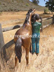 Dreams Come True bronze sculpture of girl petting her pony horse