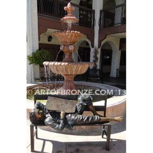 A Wonderful Day Full View Bronze Statue of boy on bench napping with Newpaper