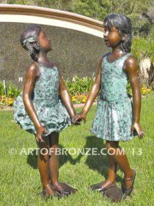 Dance Partners bronze sculpture of two ballerinas holding hands