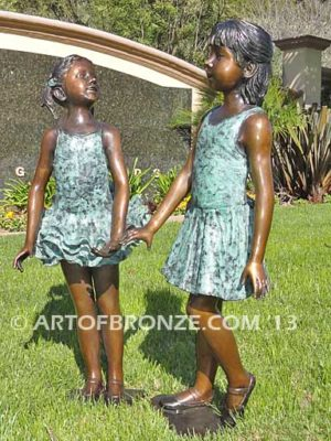 Dance Partners bronze sculpture of two ballerinas holding hands