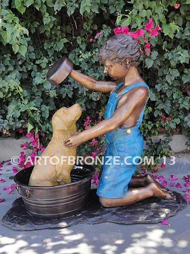 Bath time bronze statue of boy washing his dog