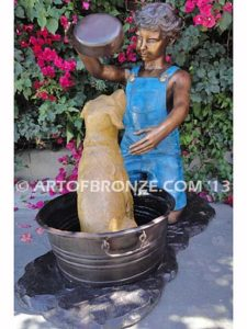 Bath Time front view bronze statue of boy washing his dog