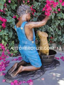 Bath Time back view bronze statue of boy washing his dog