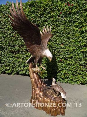 Dinner for Two statue of a life-size bald eagle and its eaglet in nest