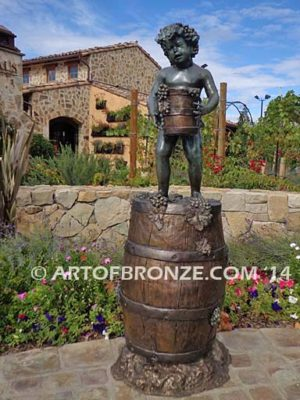 Harvest Time bronze sculpture of cherub boy standing on wine barrel with grapes