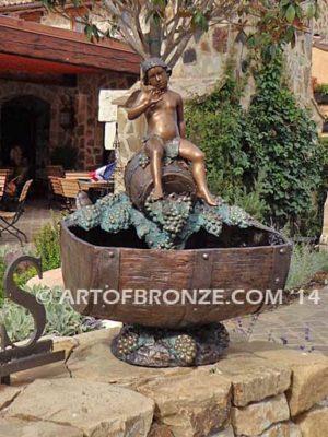 Special Reserve bronze sculpture fountain of cherub sitting on wine barrel