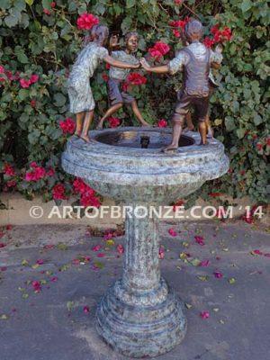 Playground Joy bronze fountain sculpture of kids dancing around