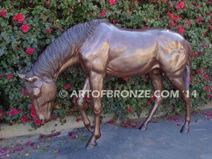 Thoroughbred bronze sculpture of grazing horse for ranch or equestrian center