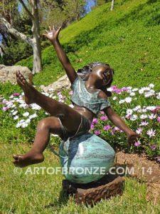 Favorite Student bronze sculpture of girl atop apple