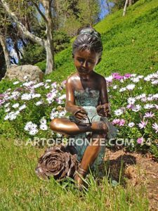 Blooming Youth front view bronze sculpture of young ballerina sitting tying her slipper
