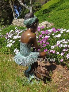 Blooming Youth back view A bronze sculpture of young ballerina sitting tying her slipper