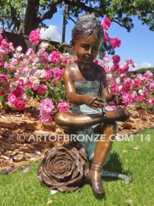 Blooming Youth III bronze sculpture of young ballerina sitting tying her slipper