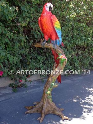 Scarlet Macaw outdoor statue of life-size wild Macaw on a branch