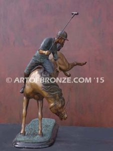 Change of Direction sculpture of polo player riding his leaping polo pony attached to a marble base