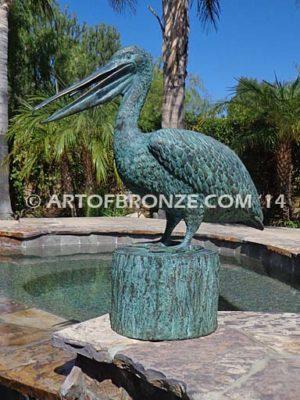 Fisherman bronze statue of tranquil pelican on bronze piling