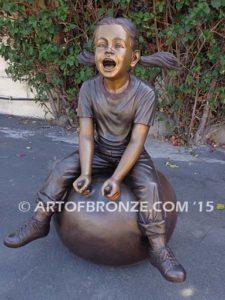 Hop Ball bronze sculpture of girl bouncing on hop ball