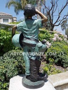 Home of the Brave bronze sculpture of saluting boy dressed up playing soldier