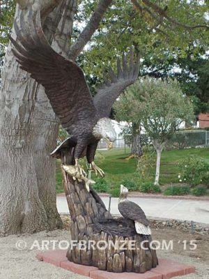 Dinner for Two* statue of a life-size bald eagle feeding its baby eaglet in nest