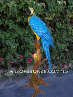 Blue and Gold Macaw statue of life-size wild Macaw on a branch
