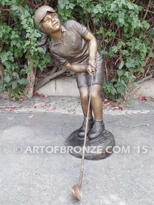 Chip Shot bronze sculpture girl hitting golf ball