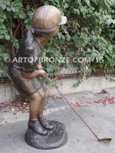 Chip Shot bronze sculpture girl hitting golf ball