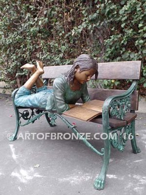 Best in Class bronze statue of girl lying down reading book