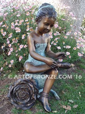 Blooming Youth bronze sculpture of young ballerina sitting tying her slipper