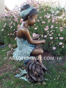 Blooming Youth side view D bronze sculpture of young ballerina sitting tying her slipper