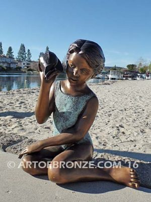 Ocean Sounds Lake Front View bronze sculpture of bathing suit girl with conch shell fountain