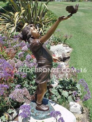 Faith and Hope bronze sculpture of young standing girl with doves in her hands