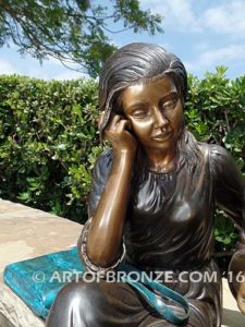 Big Sister Love closeup B bronze statue of two girls sitting and drawing