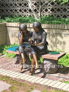 Big Sister Love DV bronze statue of two girls sitting and drawing