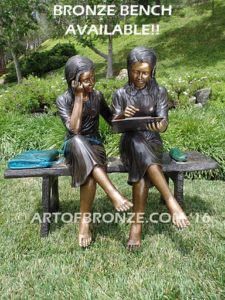 Big Sister Love Bnc bronze statue of two girls sitting and drawing