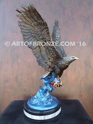 Bronze sculpture of flying eagle with captured salmon on custom marble base