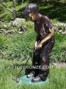 All Lined Up Bronze statue of boy putting golf ball