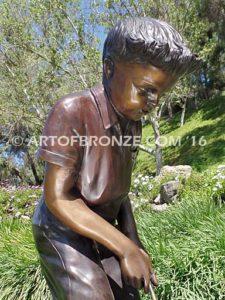 All Lined Up closeup Bronze statue of boy putting golf ball
