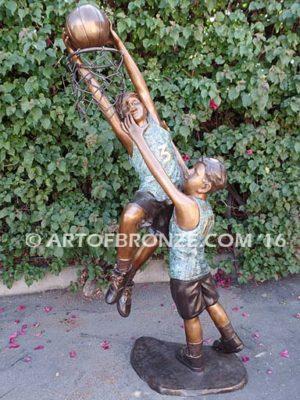Taking it to the Hoop bronze sculpture of junior basketball players dunking