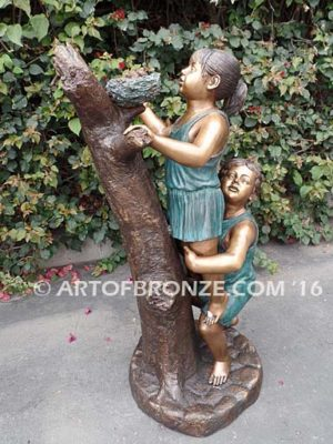 Baby Rescue Bronze Statue boy and girl looking at bird nest