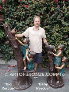 Big Rescue both Bronze statue of boy and girl rescuing with cat in tree