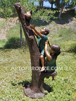 Big Rescue Bronze statue of boy and girl rescuing with cat in tree