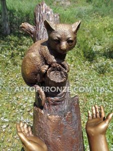 Big Rescue closeup C Bronze statue of boy and girl rescuing with cat in tree