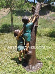 Big Rescue back view B Bronze statue of boy and girl rescuing with cat in tree